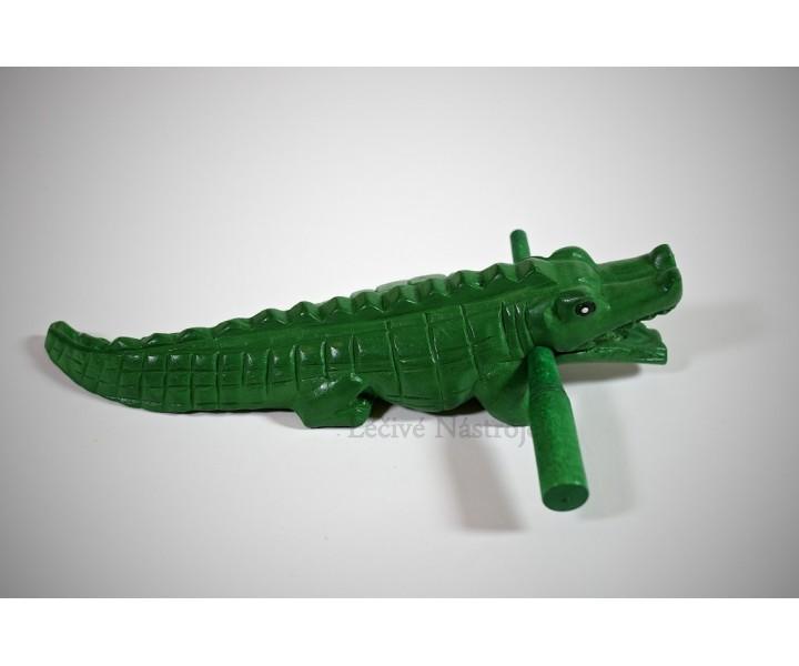 Green crocodile with stick
